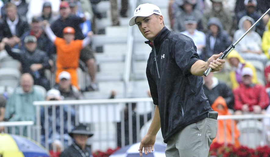 Jordan Spieth watches his birdie putt about to go in on the hole on the 18th green during the third round of the Tour Championship golf tournament at East Lake Golf Club, Saturday, Sept. 26, 2015, in Atlanta. (AP Photo/John Amis)