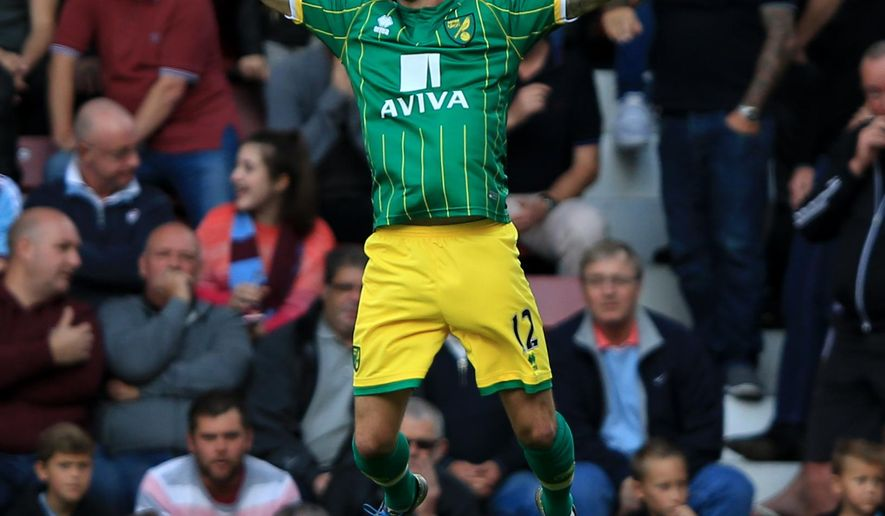Norwich City's Robbie Brady celebrates scoring their opening goal  during their English Premier League soccer match against West Ham at Upton Park, London, England, Saturday, Sept. 26, 2015. (John Walton/PA via AP)     UNITED KINGDOM OUT       -     NO SALES      -      NO ARCHIVES