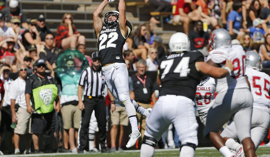 Colorado wide receiver Nelson Spruce (22) catches a pass during the first half of an NCAA college football game against Nicholls State, in Boulder, Colo., Saturday, Sept. 26, 2015. (AP Photo/Brennan Linsley)