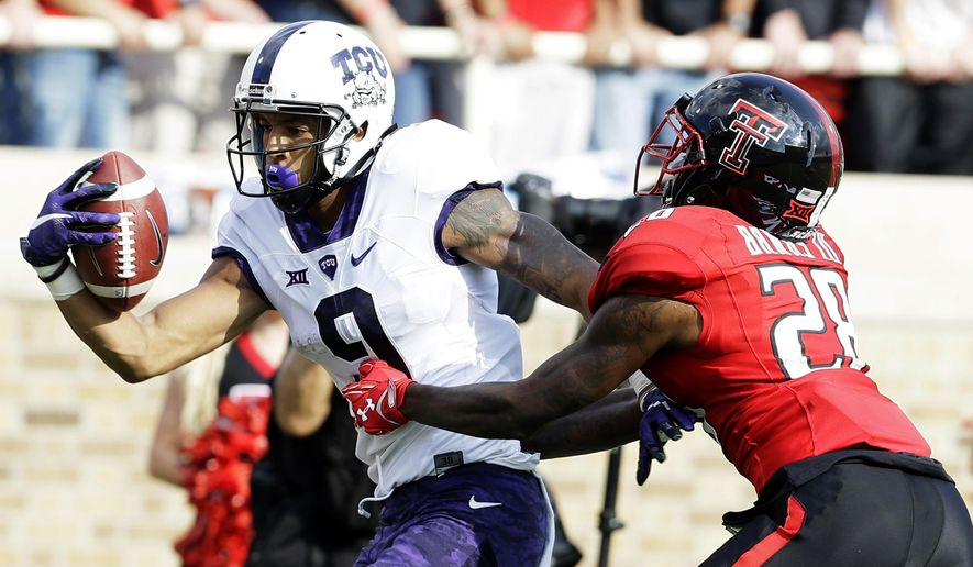 TCU wide receiver Josh Doctson (9) catches a touchdown pass against Texas Tech defensive back Paul Banks (28) during the first half of an NCAA college football game Saturday, Sept. 26, 2015, in Lubbock, Texas. (AP Photo/LM Otero)