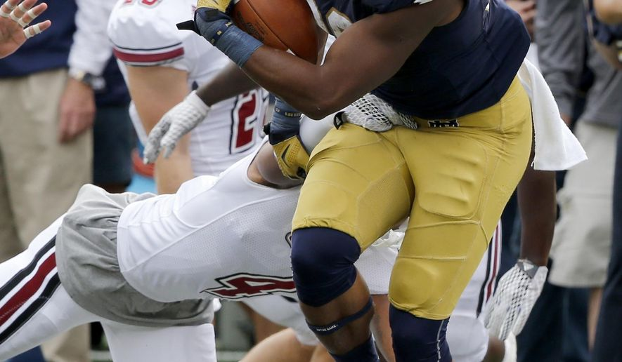 Notre Dame 's C.J. Prosise carries the ball during the first half of an NCAA college football game against the Massachusetts Saturday, Sept. 26, 2015, in South Bend, Ind. (AP Photo/Charles Rex Arbogast)