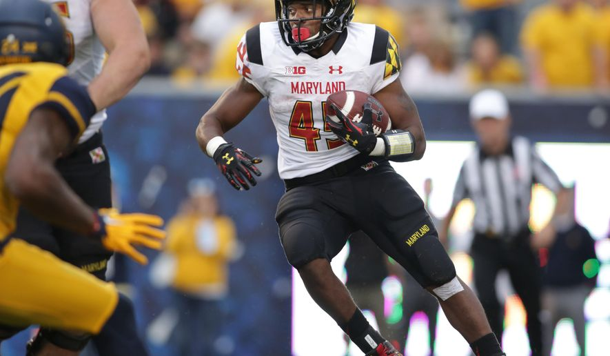 Maryland running back Brandon Ross (45) looks for a running lane during the second half of an NCAA college football game against West Virginia, Saturday, Sept. 26, 2015, in Morgantown, W.Va. West Virginia defeated Maryland 45-6. (AP Photo/Raymond Thompson)