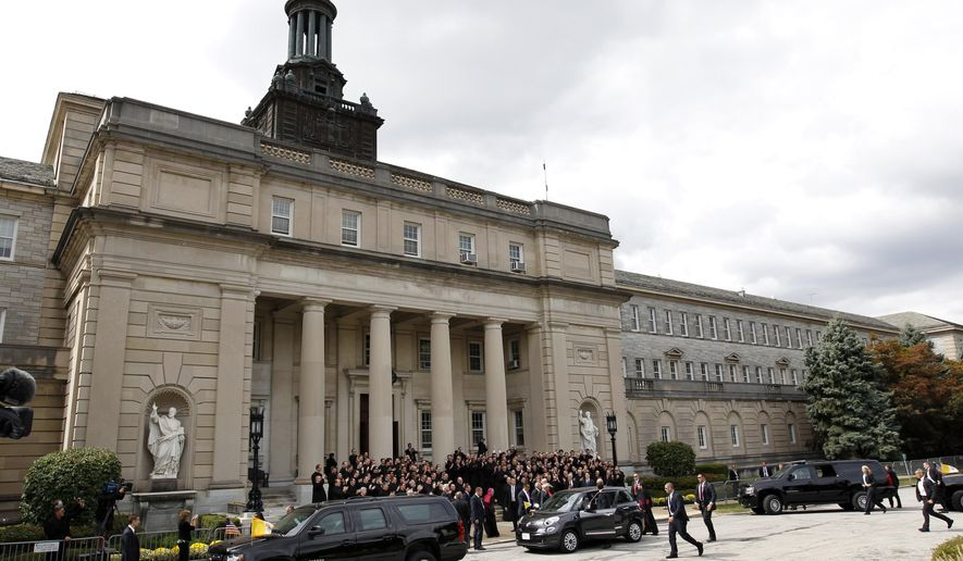 Pope Francis' Fiat is parked between two large SUVs as he arrives at St. Charles Borromeo Seminary Saturday, Sept. 26, 2015, in Wynnewood, Pa. (AP Photo/Mel Evans)