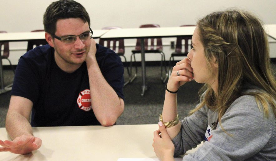In this Sept. 9, 2015, photo, Eastern Illinois University student Nick Teresky, left, explains to graduate assistant Meghan Levy some issues and triumphs he has had overcoming the symptoms of his high-functioning autism during a group support session for students with autism in Charleston, Ill. The autism mentoring program is the only one of its kind in much of the Midwest. (Jarad Jarmon/Times-Courier via AP)