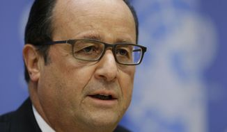 French President Francois Hollande speaks at a news conference at U.N. headquarters, Sunday, Sept. 27, 2015. President Hollande says six French jet fighters targeted and destroyed an Islamic State training camp in eastern Syria. (AP Photo/Seth Wenig)