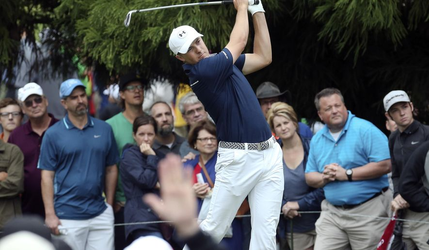 Jordan Spieth hits from the tee on the second hole in the final round of the Tour Championship golf tournament at East Lake Golf Club, Sunday, Sept. 27, 2015, in Atlanta. (AP Photo/John Bazemore)