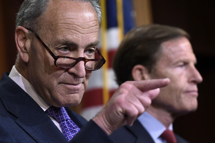 File-This May 7, 2015, file photo shows Sen. Charles Schumer, D-N.Y., left, accompanied by Sen. Richard Blumenthal, D-Conn., calling on a reporter during a news conference on Capitol Hill in Washington.  Schumer, says in a statement released early Sunday, Sept. 27, 2015, that the Federal Trade Commission, which is reviewing its regulations on eyeglasses, should require eyecare providers to give complete eyeglass prescription information to consumers. Schumer says consumers could then use this information to shop around for the best deals on glasses. Schumer is also calling for the FTC to require eyecare providers to verify information about a prescription to third-party sellers in a reasonable amount of time.  (AP Photo/Susan Walsh, File)