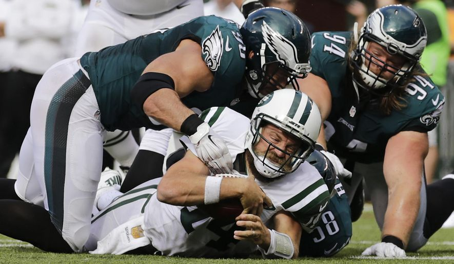 New York Jets quarterback Ryan Fitzpatrick (14) is sacked by Philadelphia Eagles linebacker Marcus Smith (90) and outside linebacker Jordan Hicks (58) during the fourth quarter of an NFL football game, Sunday, Sept. 27, 2015, in East Rutherford, N.J. (AP Photo/Adam Hunger)