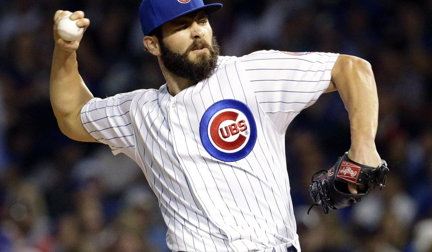 Chicago Cubs starter Jake Arrieta throws against the Pittsburgh Pirates during the first inning of a baseball game Sunday, Sept. 27, 2015, in Chicago. (AP Photo/Nam Y. Huh)