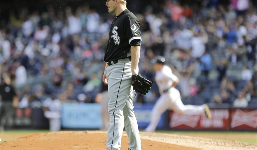 Chicago White Sox starting pitcher Erik Johnson (45) reacts as New York Yankees' Dustin Ackley runs the bases after hitting a home run during the sixth inning of a baseball game, Sunday, Sept. 27, 2015, in New York. (AP Photo/Frank Franklin II)