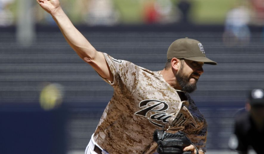 San Diego Padres starting pitcher James Shields throws to the plate against the Arizona Diamondbacks during the first inning of a baseball game in San Diego, Sunday, Sept. 27, 2015. (AP Photo/Alex Gallardo)