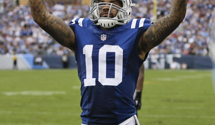 Indianapolis Colts wide receiver Donte Moncrief (10) celebrates after catching an 11-yard pass for a touchdown against the Tennessee Titans in the second half of an NFL football game Sunday, Sept. 27, 2015, in Nashville, Tenn. (AP Photo/James Kenney)