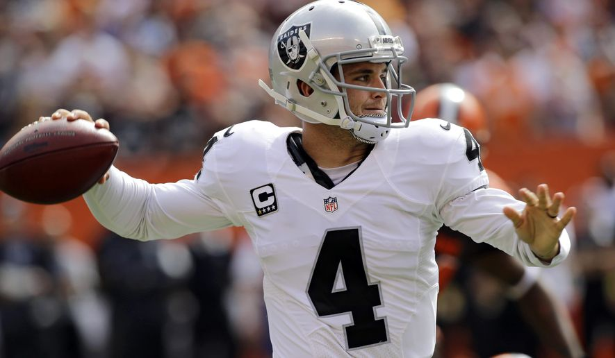Oakland Raiders quarterback Derek Carr throws in the first half of an NFL football game against the Cleveland Browns, Sunday, Sept. 27, 2015, in Cleveland. (AP Photo/Aaron Josefczyk)