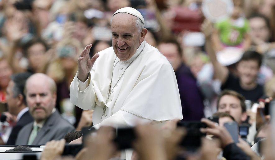 Pope Francis acknowledges faithful as he parades on his way to celebrate Mass Sunday, Sept. 27, 2015, in Philadelphia. (AP Photo/Matt Rourke, Pool) **FILE**