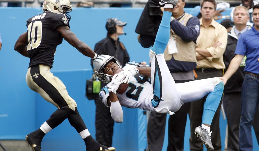 Carolina Panthers' Josh Norman, right, intercepts a pass in front of New Orleans Saints' Brandin Cooks during the second half of an NFL football game in Charlotte, N.C., Sunday, Sept. 27, 2015. The Panthers won 27-22. (AP Photo/Bob Leverone)