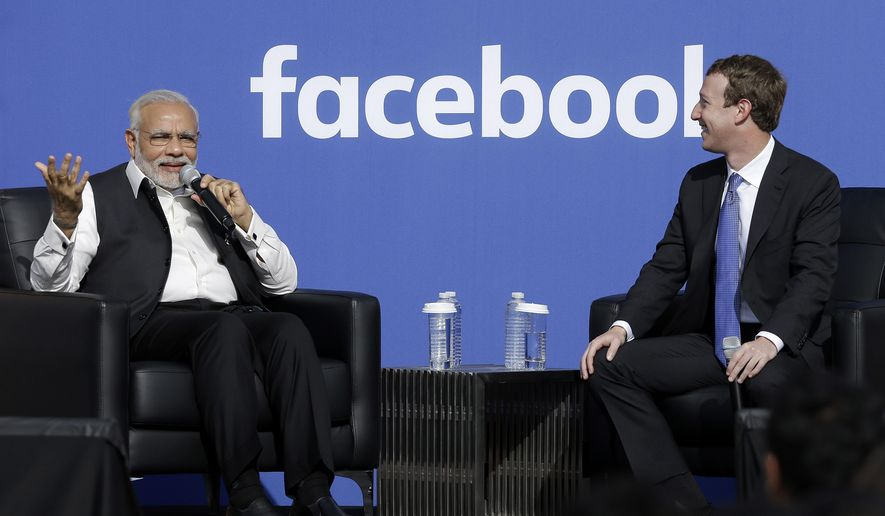 Prime Minister of India Narendra Modi, left, speaks next to Facebook CEO Mark Zuckerberg at Facebook in Menlo Park, Calif., Sunday, Sept. 27, 2015.  A rare visit by Indian Prime Minister Narendra Modi this weekend has captivated his extensive fan club in the area and commanded the attention of major U.S. technology companies eager to extend their reach into a promising overseas market. (AP Photo/Jeff Chiu)