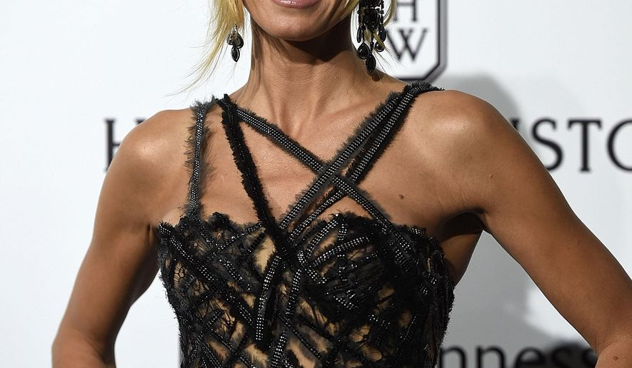Model Heidi Klum arrives for the amfAR charity dinner during the fashion week in Milan, Italy, Saturday, Sept. 26, 2015 (AP Photo/Giuseppe Aresu)