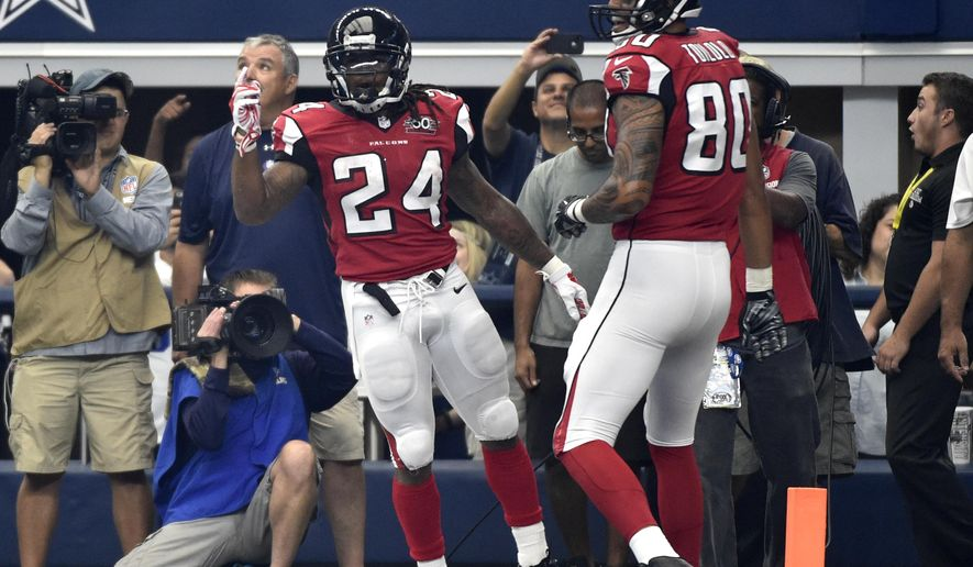 Atlanta Falcons running back Devonta Freeman (24) and tight end Levine Toilolo (80) celebrate a touchdown scored by Freeman in the first half of an NFL football game against the Dallas Cowboys, Sunday, Sept. 27, 2015, in Arlington, Texas. (AP Photo/Michael Ainsworth )