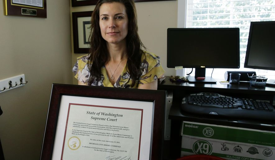 In this Aug. 12, 2015 photo, Michelle Cummings, the first limited license legal technician to be licensed in Washington state, poses for a photo in Auburn, Wash., with the certificate from the state Supreme Court that allows her to practice. The Court this year made Washington the first state to begin licensing non-lawyers to give legal advice, for a fraction of what lawyers often charge. (AP Photo/Ted S. Warren)