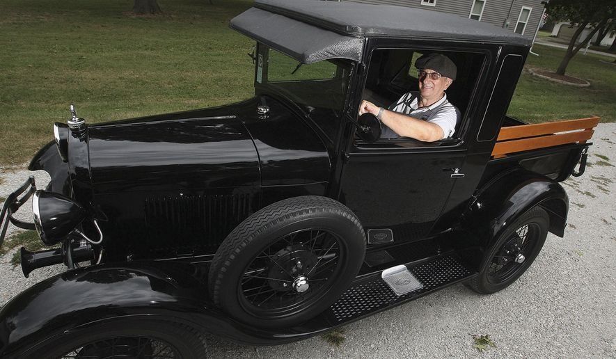 "In this Sept. 8, 2015, photo, Nathan Ruppert rides in his 1929 closed cab Model A pickup truck in Nokomis, Ill. Ruppert annually organizes a local celebration in Nokomis for ""Model A Day."" (Jim Bowling/Herald & Review via AP) MANDATORY CREDIT"