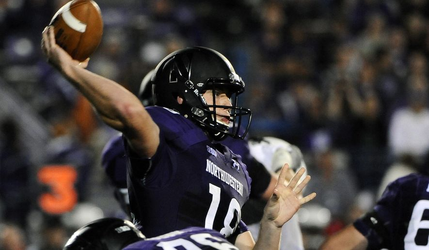 Northwestern quarterback Clayton Thorson passes against Ball State during the third quarter of an NCAA college football game in Evanston, Ill., Saturday, Sept. 26, 2015. (AP Photo/Matt Marton)
