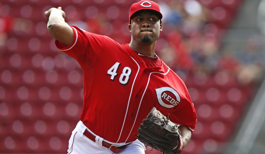 Cincinnati Reds starting pitcher Keyvius Sampson (48) delivers in the first inning of a baseball game against the New York Mets, Sunday, Sept. 27, 2015, in Cincinnati. (AP Photo/Aaron Doster)