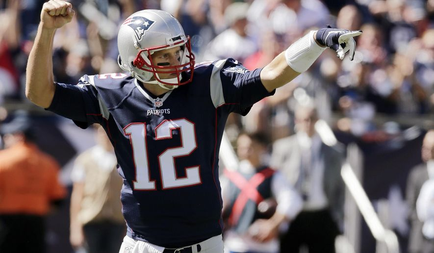New England Patriots quarterback Tom Brady celebrates a touchdown run by running back Dion Lewis in the first half of an NFL football game Jacksonville Jaguars , Sunday, Sept. 27, 2015, in Foxborough, Mass. (AP Photo/Charles Krupa)