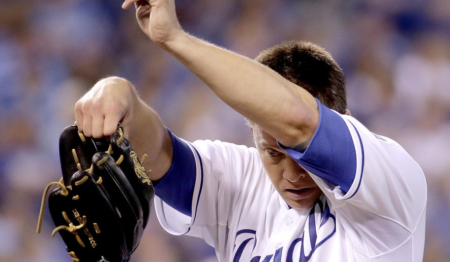 Kansas City Royals relief pitcher Kris Medlen comes out of the game during the fourth inning of a baseball game against the Cleveland Indians Saturday, Sept. 26, 2015, in Kansas City, Mo. (AP Photo/Charlie Riedel)