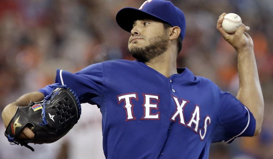 Texas Rangers' Martin Perez delivers a pitch against the Houston Astros in the first inning of a baseball game Sunday, Sept. 27, 2015, in Houston. (AP Photo/Pat Sullivan)