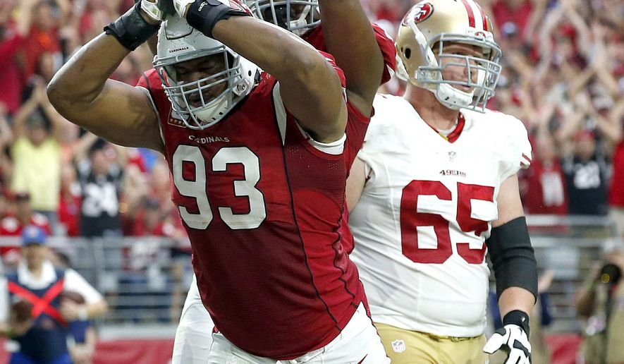 Arizona Cardinals defensive end Calais Campbell (93) signals safety during the second half of an NFL football game against the San Francisco 49ers, Sunday, Sept. 27, 2015, in Glendale, Ariz.  (AP Photo/Ross D. Franklin)