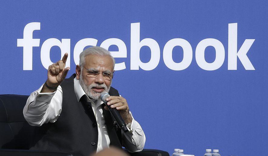 Prime Minister of India Narendra Modi speaks at Facebook in Menlo Park, Calif., in this Sunday, Sept. 27, 2015, file photo. (AP Photo/Jeff Chiu) ** FILE **