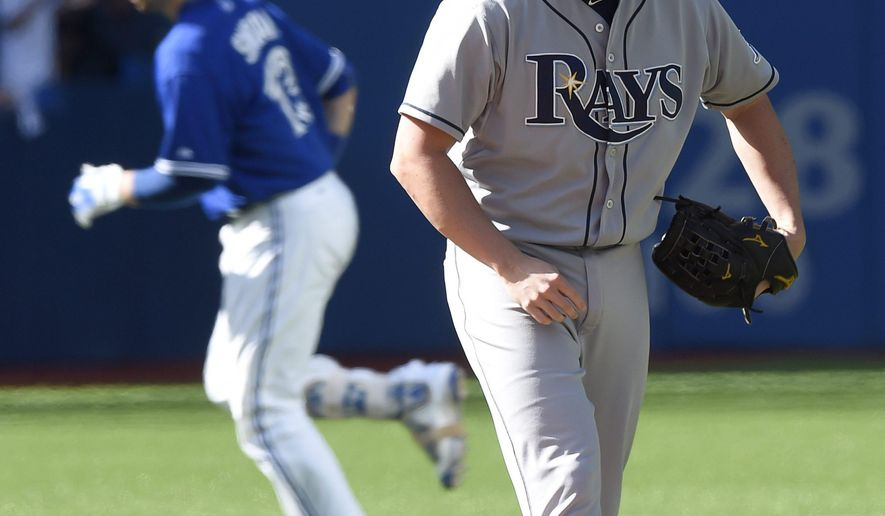 Toronto Blue Jays' Justin Smoak rounds the bases on his two-run home run against Tampa Rays Brandon Gomes during the sixth inning of a baseball game in Toronto, Sunday, Sept. 27, 2015. (Frank Gunn/The Canadian Press via AP) MANDATORY CREDIT