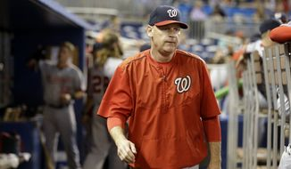 Washington Nationals manager Matt Williams walks in the dugout during a baseball game against the Miami Marlins, Sunday, Sept. 13, 2015, in Miami. The Nationals defeated the Marlins 5-0. (AP Photo/Lynne Sladky)