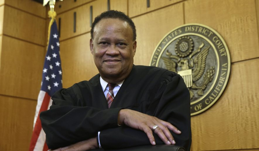 In this Thursday, Sept. 24, 2015 photo, Federal Court Judge Morrison England, Jr., the chief district judge for the Eastern District of California, poses at the Robert T. Matsui United States Courthouse in Sacramento, Calif.  With an unfilled judicial vacancy and the same number of judicial positions, six, it had in 1978, the Eastern District is among many federal district courts that have seen a rise in recent years in the time it takes to resolve civil and criminal cases as judges' workloads increase. (AP Photo/Rich Pedroncelli)