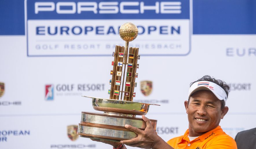 Golfer Thongchai Jaidee of Thailand holds the trophy after winning the European Open Golf tournament in Bad Griesbach, Germany, Sunday, Sept. 27, 2015. (Armin Weigel/dpa via AP)