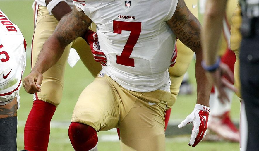 San Francisco 49ers quarterback Colin Kaepernick (7) is helped up after being hit against the Arizona Cardinals during the second half of an NFL football game, Sunday, Sept. 27, 2015, in Glendale, Ariz.  (AP Photo/Ross D. Franklin)