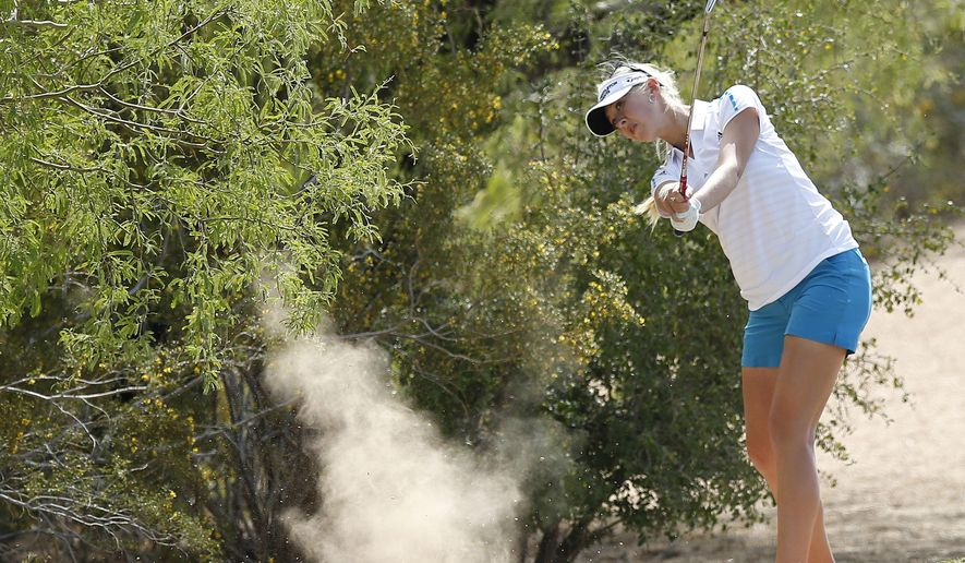 FILE - In a March 23, 2014 file photo, Jessica Korda hits a shot from off the fairway, kicking up dust, on the 2nd hole during the final round of the LPGA Founders Cup golf tournament, in Phoenix. Government statistics show that golf courses in and around Phoenix consume more water than any other place in the country. (AP Photo/Ross D. Franklin, File)