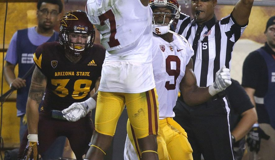 Southern California's JuJu Smith-Schuster (9) celebrates his touchdown with Steven Mitchell Jr. (7) as Arizona State's Jordan Simone (38) looks away during the first half of an NCAA college football game Saturday, Sept. 26, 2015, in Tempe, Ariz. (AP Photo/Ross D. Franklin)