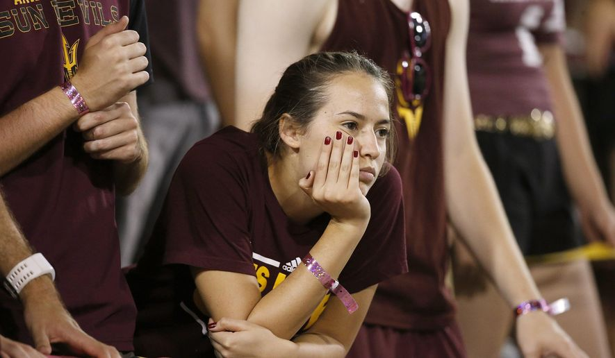 An Arizona State fan shows her disappointment during the second half of an NCAA college football game against Southern California Saturday, Sept. 26, 2015, in Tempe, Ariz. Southern California defeated Arizona State 42-14. (AP Photo/Ross D. Franklin)