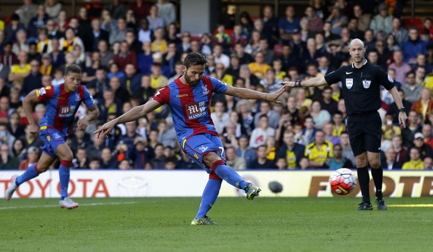 Crystal Palace's Yohan Cabaye scores a penalty during the English Premier League soccer match between Watford and Crystal Palace at Vicarage Road stadium in London, Sunday, Sept. 27, 2015.  (AP Photo/Matt Dunham)