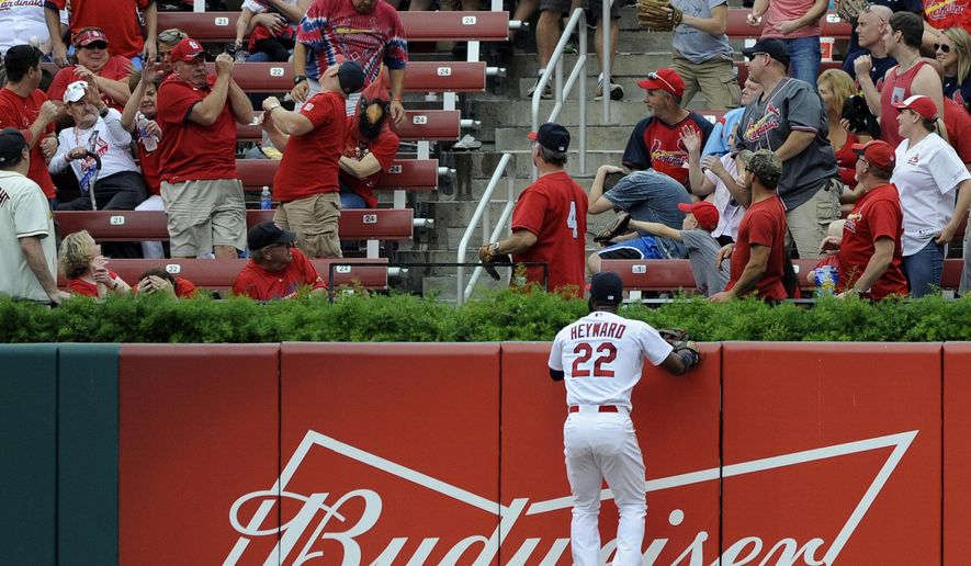 St. Louis Cardinals' Jason Heyward (22) watches a solo home run ball hit by Milwaukee Brewers' Khris Davis in the second inning of a baseball game, Sunday, Sept. 27, 2015, at Busch Stadium in St. Louis. (AP Photo/Bill Boyce)