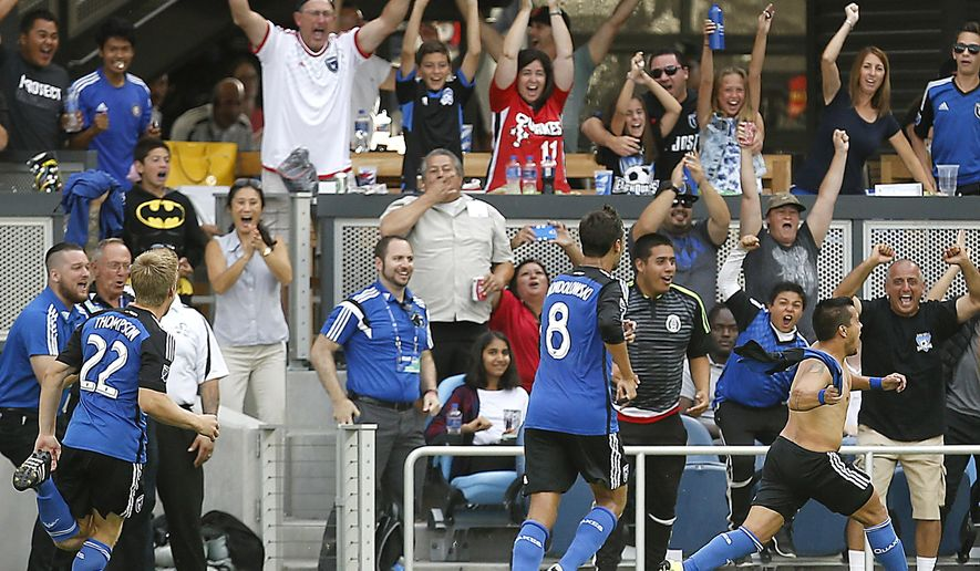 San Jose Earthquakes midfielder Matias Perez Garcia, lower right, celebrates after scoring a goal against Real Salt Lake during the second half of an MLS soccer match Sunday, Sept. 27, 2015, in San Jose, Calif. San Jose won 1-0. (AP Photo/Tony Avelar)