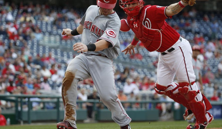 Washington Nationals catcher Wilson Ramos can't make the tag on Cincinnati Reds' Brennan Boesch during the eighth inning of a baseball game at Nationals Park, Monday, Sept. 28, 2015, in Washington. The Nationals won 5-1. (AP Photo/Alex Brandon)