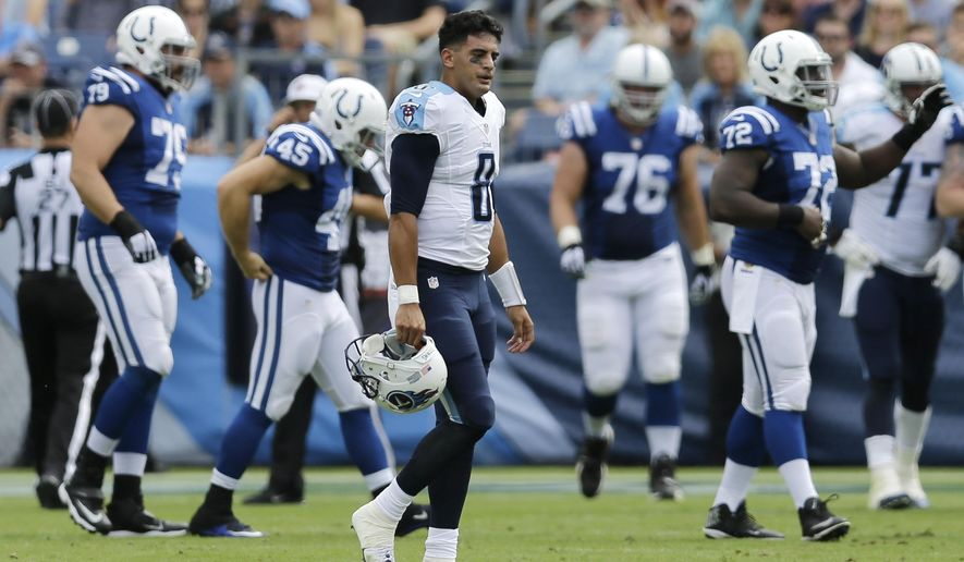 FILE - In this Sunday, Sept. 27, 2015 file photo, Tennessee Titans quarterback Marcus Mariota (8) walks off the field after Indianapolis Colts safety Dwight Lowery intercepted a pass and returned it 69 yards for a touchdown in the first half of an NFL football game in Nashville, Tenn.  The  Titans have an extra week thanks to their bye to think about the mistakes they made in blowing a 13-point lead in the fourth quarter and sole possession atop the AFC South. (AP Photo/James Kenney)