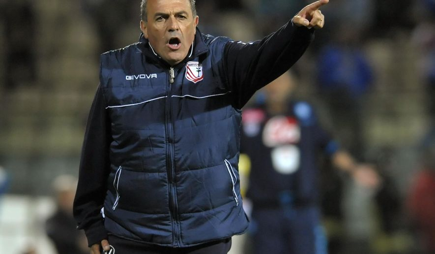 Carpi coach Fabrizio Castori  gestures during a serie A soccer match between Carpi and Napoli at Modena's Alberto Braglia Stadium, Italy, Wednesday, Sept. 23, 2015. (AP Photo/Marco Vasini)