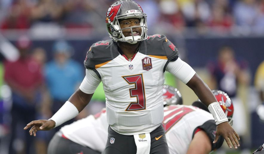 Tampa Bay Buccaneers' Jameis Winston (3) calls to teammates during the first half of an NFL football game against the Houston Texans, Sunday, Sept. 27, 2015, in Houston. (AP Photo/David J. Phillip)