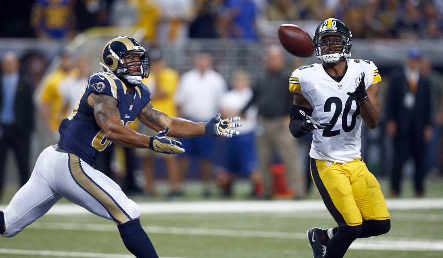 Pittsburgh Steelers strong safety Will Allen, right, intercepts a pass intended for St. Louis Rams tight end Lance Kendrick, left, during the fourth quarter of an NFL football game Sunday, Sept. 27, 2015, in St. Louis. (AP Photo/Billy Hurst)