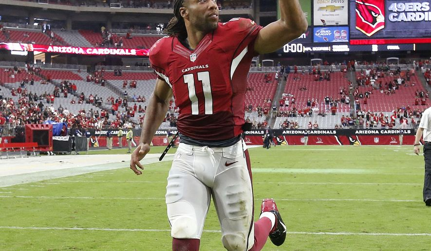 Arizona Cardinals wide receiver Larry Fitzgerald leaves the field after an NFL football game against the San Francisco 49ers, Sunday, Sept. 27, 2015, in Glendale, Ariz. The Cardinals won 47-7. (AP Photo/Rick Scuteri)