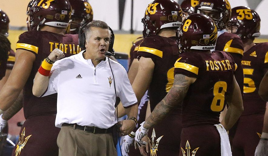 Arizona State head coach Todd Graham, left, talks with D.J. Foster (8) on the sidelines during the second half of an NCAA college football game against Southern California Saturday, Sept. 26, 2015, in Tempe, Ariz. Southern California defeated Arizona State 42-14. (AP Photo/Ross D. Franklin)