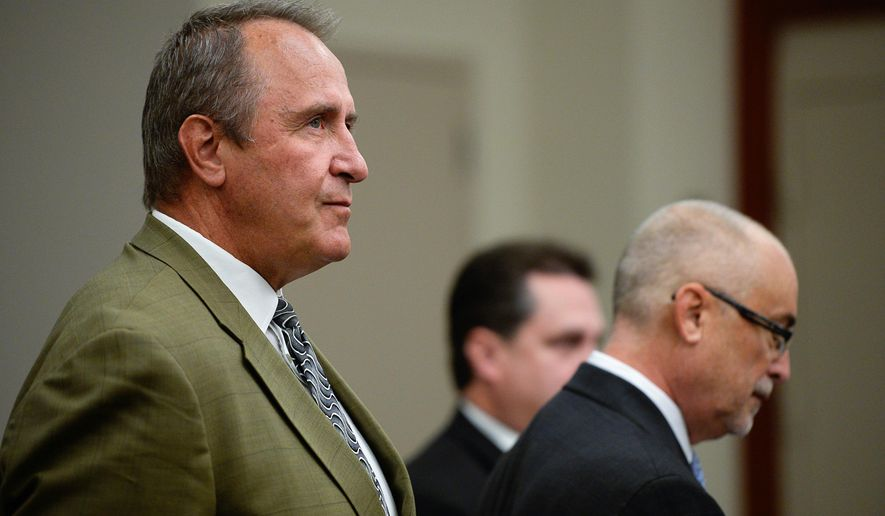 Former Utah Attorney Gen. Mark Shurtleff, left, facing public corruption charges, appears in Judge Elizabeth Hruby-Mills courtroom in Salt Lake City on Monday, Sept. 28, 2015, for a pre-trial hearing. The judge on Monday scheduled a May 2016 trial in the pay-to-play case against Shurtleff, but defense attorneys said it may be pushed back. Shurtleff, a Republican, has pleaded not guilty to seven counts of obstructing justice and accepting improper gifts. (Francisco Kjolseth/The Salt Lake Tribune via AP, Pool)